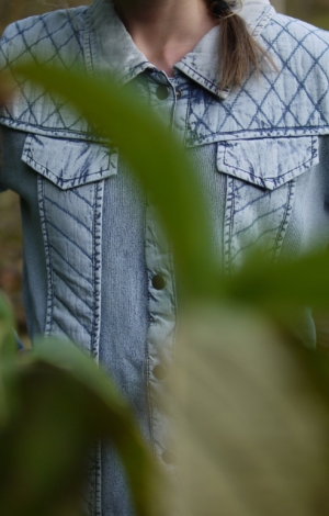 Close up. Basic jacket in light indigo blue. Piece of Blue