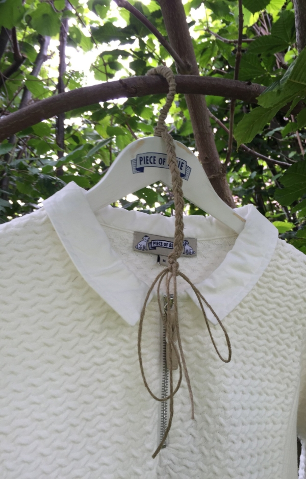 Close up. Basic and Elegant Pullover in White. Piece of Blue.