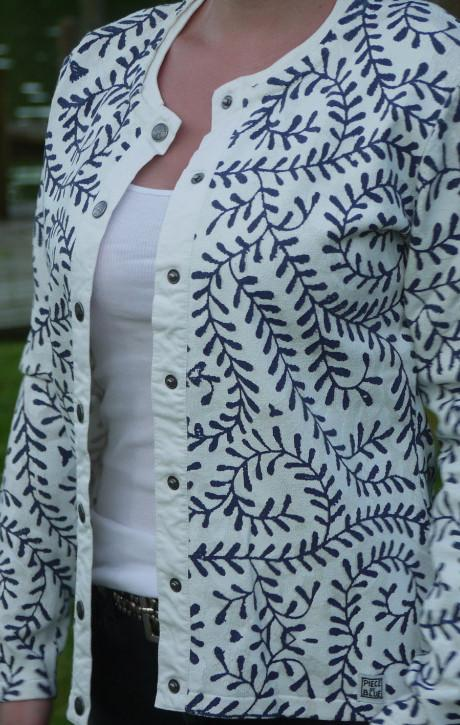 White Cardigan with Print in Dark Blue all over from Piece of Blue on model close up