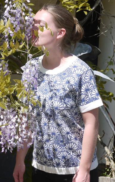 Feminine short Sleeved Pullover in White with flower Print from Piece of Blue  on model