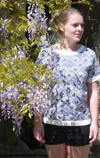 Feminine short Sleeved Pullover in White with flower Print from Piece of Blue  on model two