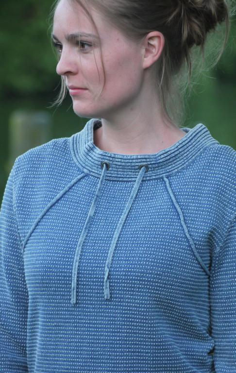 Light Indigo Blue Pullover in Feminine Knit Pattern for Her from Piece of Blue on model close up