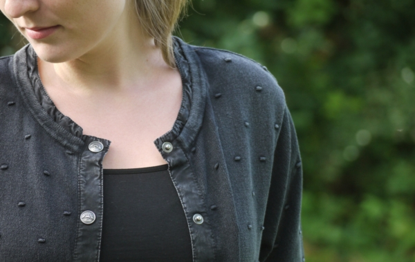 Black Grey Cardigan with Knitted Dot Pattern for Women from Piece of Blue. Close up.