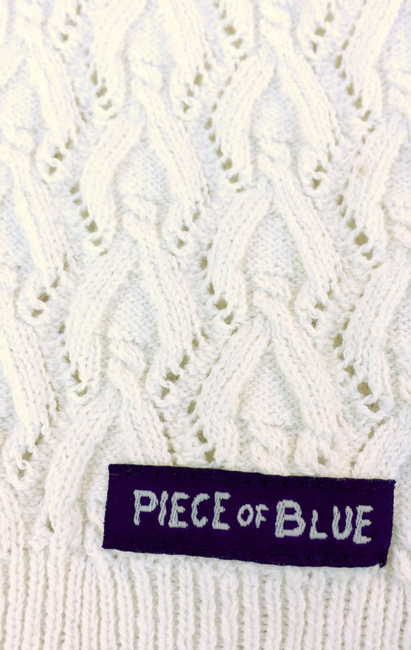 Feminine short-sleeved Pullover in white for Women from Piece of Blue. Close up 2.