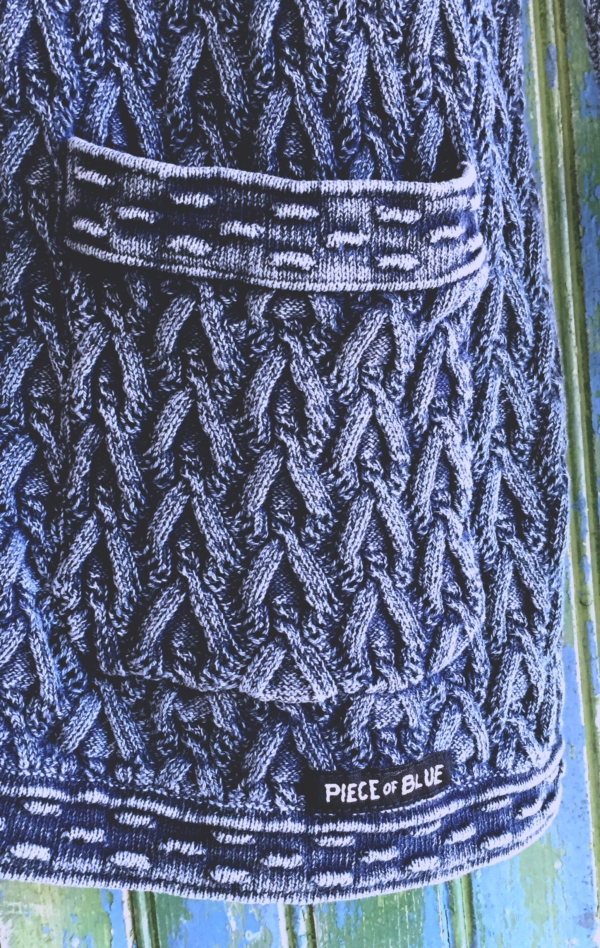 Pretty and Feminine Knitted Cardigan in Blue for Women from Piece of Blue. Close up 1.