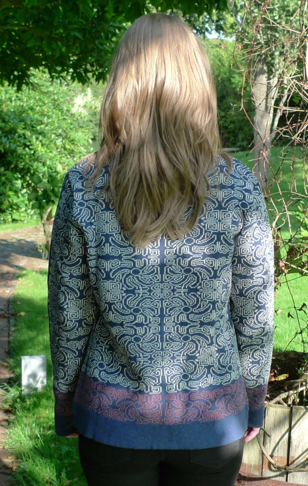 Off-White Cardigan made in Ecologic Yarn Knitted in Pretty Pattern from Piece of Blue. On model, seen from behind.