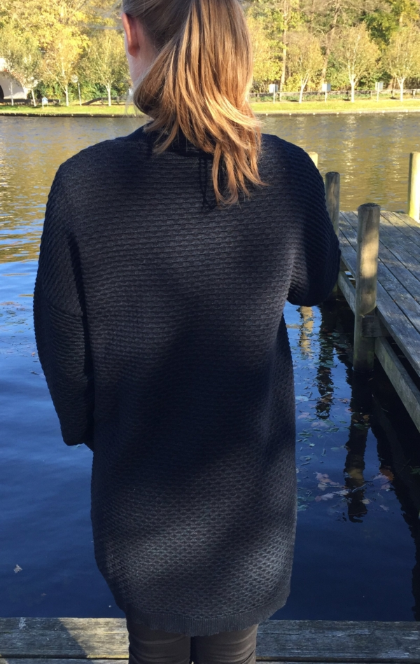 Elegant Long Wool-Cotton Knit Jacket in Dark Indigo for Women from Piece of Blue. On model from behind.